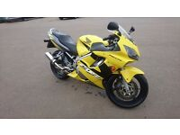 Honda cbr 600 f f4i yellow , sports exhaust great bike.