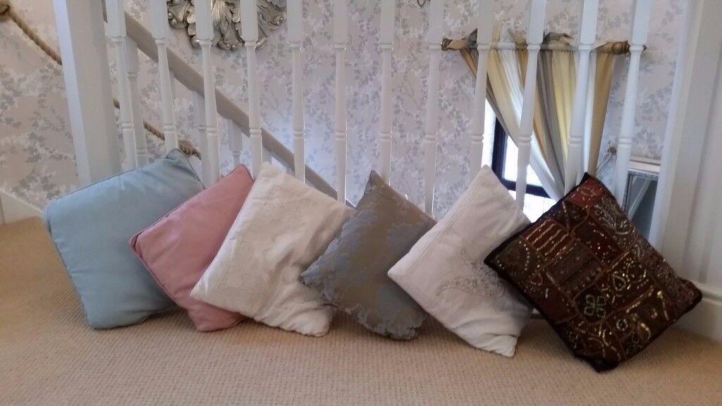 Six assorted quality cushions