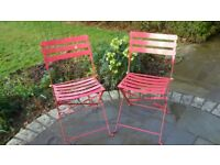 Pair of folding garden chairs, bistro style, bright pink metal.