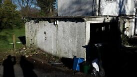 Concrete Sectional Garage (made by Bridport) partially dismantled to make way for extension
