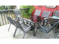 Black glass 6 seats and table