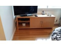 Next oak tv stand great condition 2 drawers and sludung doors wih