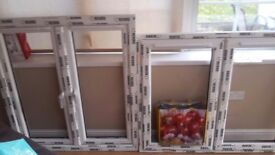 Two brand new windows for sale with glass and cills