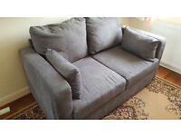 2 seater sofa bed. Grey. Used only once.