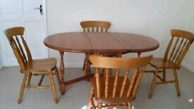 Dinning table with 4 chairs good condition folding