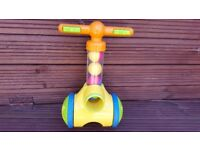 Tomy Toddler walk behind ball shooter. Scoops up and shoots out balls