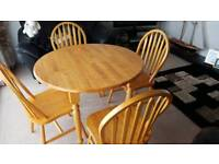 Table and chairs in pine