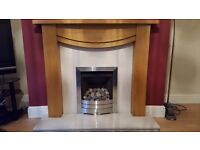 gas fire with wooden surround marble back and arth