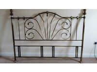"Metal headboard, silver/bronze effect, suitable for a king/super king bed. 6' wide 4'7"" height."