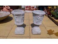 Two concrete ornate garden pots