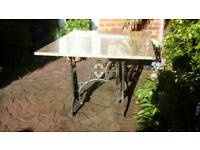Ornate cast iron , treddle base with granite table top