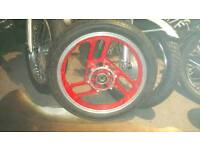Yamaha ypvs 350 front wheel and tyre.