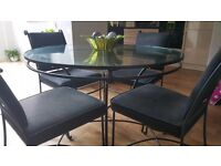 Marks & spencers solid wrought iron and glass table and 4 chairs very heavy and strong
