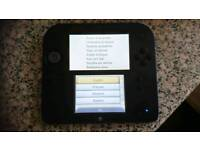 Nintendo 2DS with charger and 9 games.