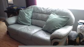 Lite green Leather three seater sofar very good condition hardly used.