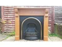LARGE CAST IRON FIREPLACE AND SOLID PINE SURROUND, NEVER BEEN USED FOR A REAL FIRE.