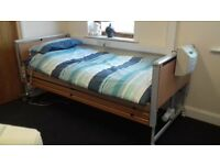 Invacare electric hospital bed with rails and 1000 comfort mattress
