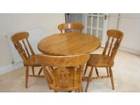Circular drop leaf table and four chairs