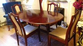 extending dining table and chairs solid but chairs need a clean priced to sell