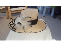 Cream and black failsworth hat with feather detailing