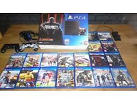 Playstation 4 , 500GB with 18 top games plus accessories