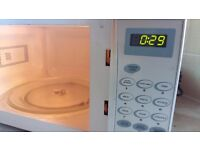 Silver microwave, in perfect working order. delivery is available if required.