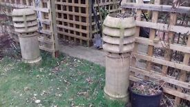 Ornate chimney pots for planting out in Garden