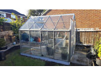 Green House with sliding door and window couple of cracked panes but replaceable