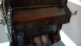 Antique bell organ mahogany in working condition.