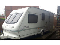 Elddis Typhoon L shape ex2000 4 Berth Touring Caravan With End Washroom