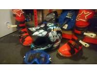 Motocross helmet, goggles, and boots