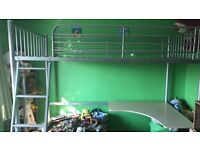 Metal single high sleeper bed with mattress. Matching desk and chair.