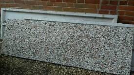 Three concrete gravel boards