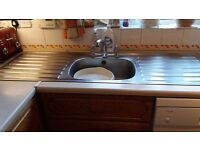 Stainless steel sink with double drainer