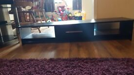 Low black tv unit.. Just a few chips out of it on the front as shown. All ok otherwise... £40.00....