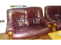 Two 2 seater vintage wood and leather sofas