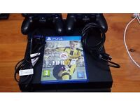 ps4 for sale in mint condition comes with two controllers and fifa 17 and wires