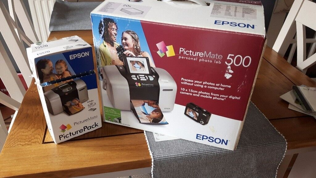Photo printer with spare paper and ink