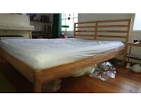 IKEA king size wooden bed frame (mattress not included)