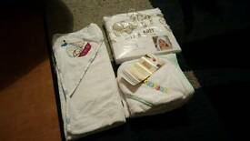 Baby grow bags x4 and some towles
