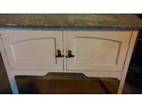 Old washroom cupboard with marble top