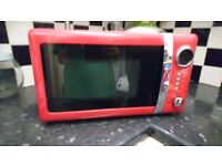 Nearly new red microwave - manual included