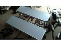 Camping tables and chairs and benches