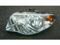 Chrysler Voyager headlight head light lamp headlamp N/S left hand breaking