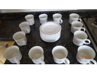 A Set of 12 Cups and Saucers