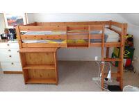 Wooden cabin bed with shelves & desk