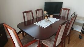 Mahogany extendable dining table and six chairs