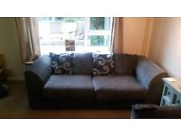 Two grey sofa's