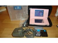 nintendo ds with 2 spare batteries 1 game headphones and charger