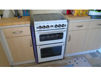 NEW WORLD GAS COOKER WHITE AND BLACK